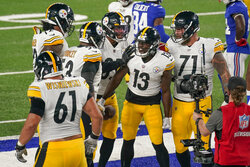 Pittsburgh Steelers wide receiver James Washington (13) celebrates with teammates after scoring a touchdown against the New York Giants during the second quarter of an NFL football game Monday, Sept. 14, 2020, in East Rutherford, N.J. (AP Photo/Seth Wenig)