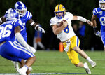 Pittsburgh's Kenny Pickett (8) carries the ball during the first half of an NCAA college football game against Duke in Durham, N.C., Saturday, Oct. 5, 2019. (AP Photo/Ben McKeown)