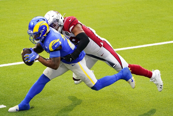 Los Angeles Rams running back Cam Akers, left, runs against Arizona Cardinals middle linebacker Jordan Hicks during the first half of an NFL football game in Inglewood, Calif., Sunday, Jan. 3, 2021. (AP Photo/Jae C. Hong)