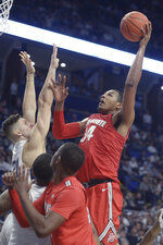 Ohio State's Kaleb Wesson (34) puts up a left-handed shot over Penn State's John Harrar (21) in an NCAA college basketball game, Saturday, Jan. 18, 2020, in State College, Pa. (AP Photo/Gary M. Baranec)