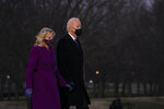 President-elect Joe Biden and his wife Jill Biden arrive for a COVID-19 memorial event at the Lincoln Memorial Reflecting Pool, Tuesday, Jan. 19, 2021, in Washington. (AP Photo/Evan Vucci)