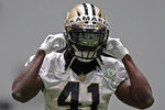 The field is reflected in the visor of New Orleans Saints running back Alvin Kamara (41) during practice at their NFL football training facility in Metairie, La., Wednesday, Sept. 2, 2020. (AP Photo/Gerald Herbert, Pool)