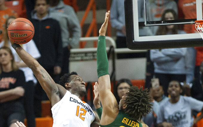 Baylor forward Freddie Gillespie (33) blocks the dunk from Oklahoma State forward Cameron McGriff (12) during an NCAA college basketball game in Stillwater, Okla., Saturday, Jan. 18, 2020. Baylor defeated Oklahoma State 75-68.(AP Photo/Brody Schmidt)