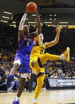 DePaul forward Paul Reed (4) grabs a rebound in front of Iowa forward Ryan Kriener (15) during the second half of an NCAA college basketball game, Monday, Nov. 11, 2019, in Iowa City, Iowa. DePaul won 93-78. (AP Photo/Charlie Neibergall)