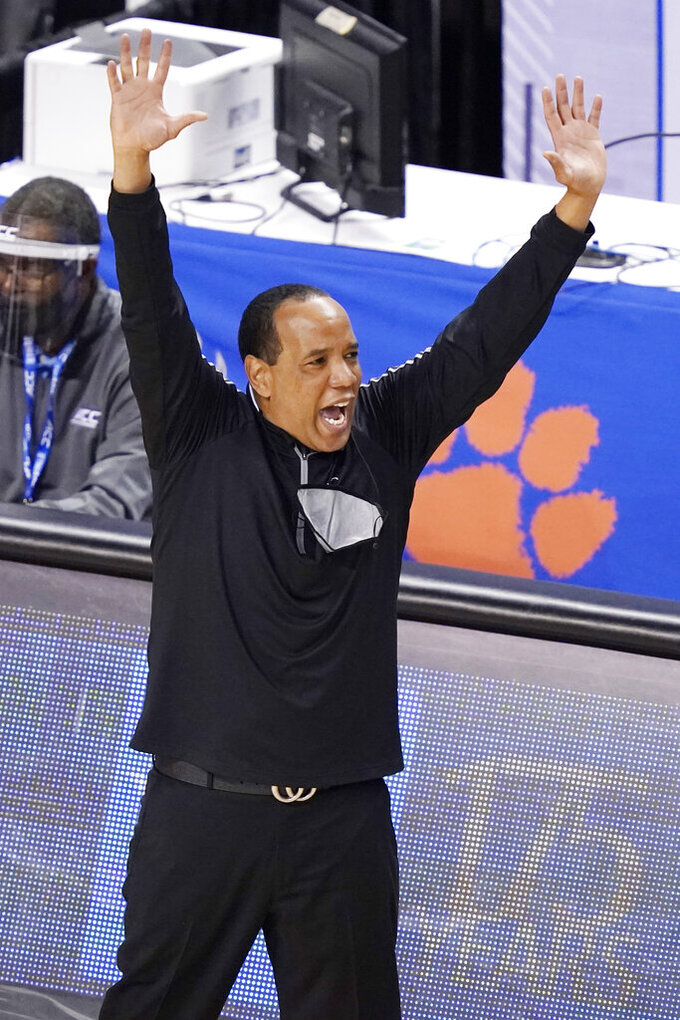 North Carolina State head coach Kevin Keatts directs his team during the first half of an NCAA college basketball game against Syracuse in the second round of the Atlantic Coast Conference tournament in Greensboro, N.C., Wednesday, March 10, 2021. (AP Photo/Gerry Broome)