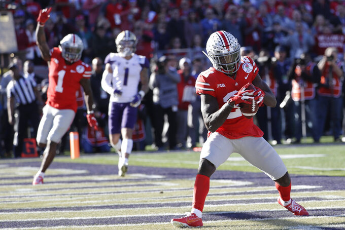 Ohio State wide receiver Parris Campbell makes a touchdown catch against Washington during the first half of the Rose Bowl NCAA college football game Tuesday, Jan. 1, 2019, in Pasadena, Calif. (AP Photo/Jae C. Hong)