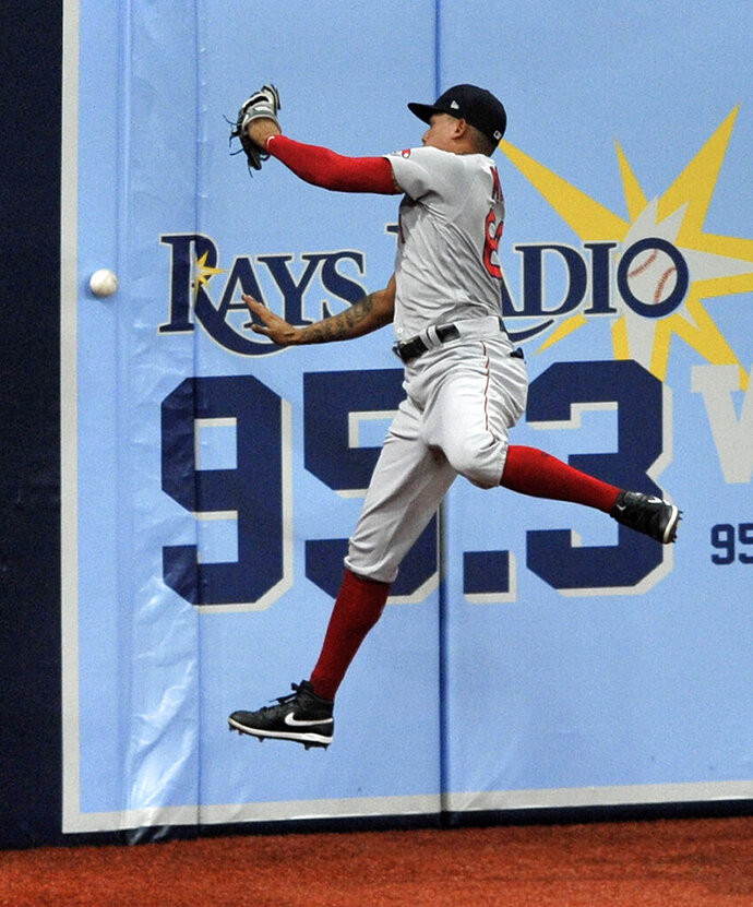 Boston Red Sox left fielder Yairo Munoz can't reach a double off the wall hit by Tampa Bay Rays' Ji-Man Choi during the first inning of a baseball game Saturday, Sept. 12, 2020, in St. Petersburg, Fla. (AP Photo/Steve Nesius)