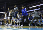 The Kentucky bench celebrates during the second half of a men's NCAA tournament college basketball Midwest Regional semifinal game against Houston, Friday, March 29, 2019, in Kansas City, Mo. (AP Photo/Charlie Riedel)