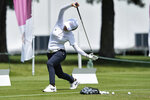 Wei-Ling Hsu, of Taiwan, stretches during a practice round prior to the women's golf event at the 2020 Summer Olympics, Monday, Aug. 2, 2021, at the Kasumigaseki Country Club in Kawagoe, Japan. (AP Photo/Andy Wong)
