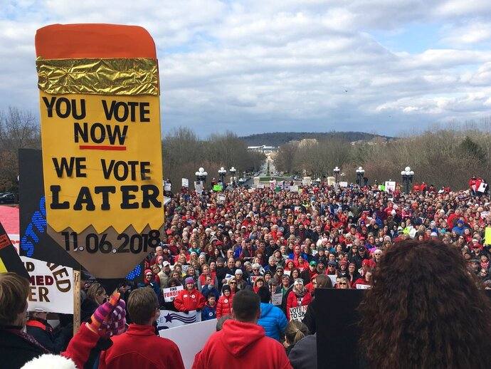 More than a thousand teachers and other public workers rally at the Kentucky Capitol to demonstrate against proposed changes to the state's pension system on Monday, March 12, 2018, in Frankfort, Ky.  (AP Phiti/Adam Beam)