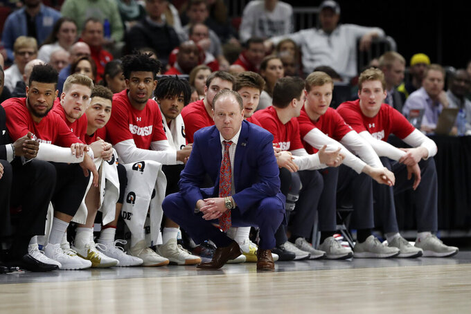 Wisconsin head coach Greg Gard and players watch from the bench during the first half of an NCAA college basketball game against Michigan State in the semifinals of the Big Ten Conference tournament, Saturday, March 16, 2019, in Chicago. (AP Photo/Nam Y. Huh)