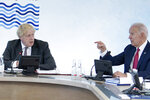 Britain's Prime Minister Boris Johnson, left, listens to US President Joe Biden during a working session at the G7 summit in Carbis Bay, Cornwall, England, Saturday, June 12, 2021. (Brendan Smialowski/Pool Photo via AP)