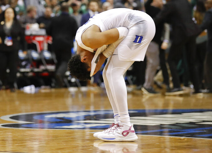 Duke guard Tre Jones covers his face after losing to Michigan State in the NCAA men's East Regional final college basketball game in Washington, Sunday, March 31, 2019. Michigan State won 68-67. (AP Photo/Alex Brandon)
