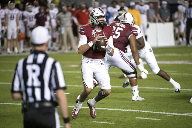 South Carolina quarterback Collin Hill (15) looks for an open receiver during the first half of the team's NCAA college football game against Texas A&M on Saturday, Nov. 7, 2020, in Columbia, S.C. (AP Photo/Sean Rayford)