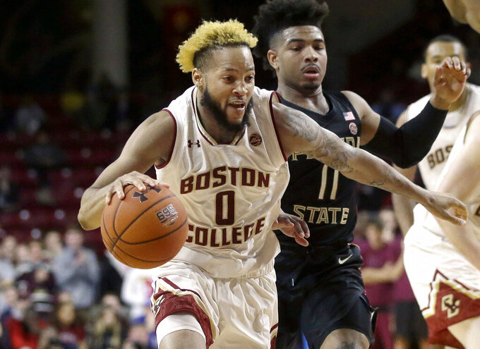 Boston College's Ky Bowman (0) drives toward the basket past Florida State's David Nichols (11) in the second half of an NCAA college basketball game, Sunday, Jan. 20, 2019, in Boston. (AP Photo/Steven Senne)