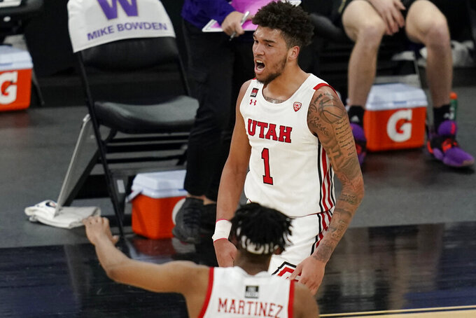 Utah's Timmy Allen (1) celebrates after a play against Washington during the first half of an NCAA college basketball game in the first round of the Pac-12 men's tournament Wednesday, March 10, 2021, in Las Vegas. (AP Photo/John Locher)