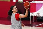 Canada forward Natalie Achonwa grabs a rebound during a women's basketball practice at the 2020 Summer Olympics, Saturday, July 24, 2021, in Saitama, Japan. (AP Photo/Charlie Neibergall)