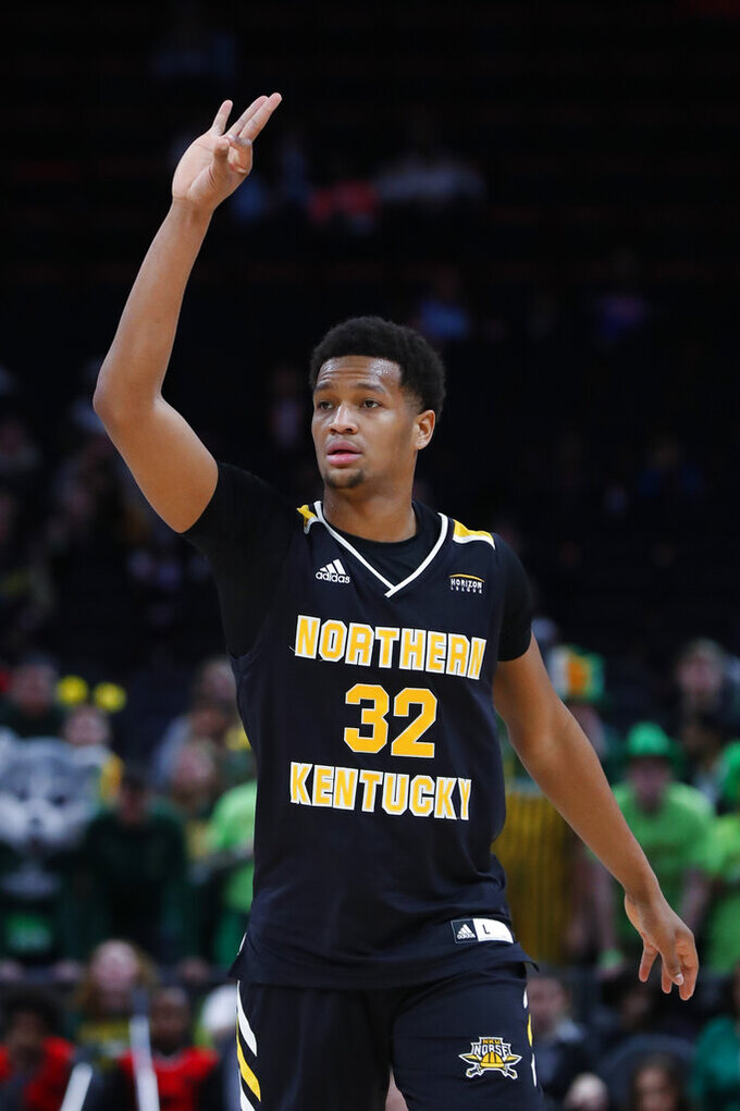 Northern Kentucky forward Dantez Walton (32) celebrates a 3-point shot against Wright State during the second half of an NCAA college basketball game for the Horizon League men's tournament championship in Detroit, Tuesday, March 12, 2019. (AP Photo/Paul Sancya)