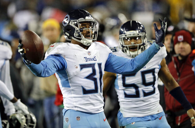 FILE - In this Saturday, Dec. 22, 2018 file photo, Tennessee Titans free safety Kevin Byard (31) celebrates after intercepting a pass against the Washington Redskins late in the fourth quarter of an NFL football game in Nashville, Tenn. The Tennessee Titans have made Kevin Byard the NFL's highest-paid safety with a contract extension hours before they report for training camp. The Titans announced the multi-year deal Wednesday night, July 24, 2019. (AP Photo/James Kenney, File)