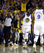 Golden State Warriors' Draymond Green (23) celebrates a score against the Portland Trail Blazers during the second half of Game 1 of the NBA basketball playoffs Western Conference finals Tuesday, May 14, 2019, in Oakland, Calif. (AP Photo/Ben Margot)