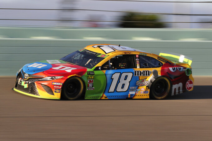 Kyle Busch drives during a NASCAR Cup Series auto racing season championship race at Homestead-Miami Speedway in Homestead, Fla., Sunday, Nov. 17, 2019. Busch won the season championship. (AP Photo/Luis M. Alvarez)