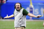 FILE - In this Jan. 1, 2020, file photo, Baylor head coach Matt Rhule reacts on the sideline in the second half of the Sugar Bowl NCAA college football game against Georgia in New Orleans. A person familiar with the situation says the Carolina Panthers are completing a contract to hire Baylor's Matt Rhule as their coach. The person spoke to The Associated Press on Tuesday, Jan. 7, 2020, on condition of anonymity because the deal is not done. The Panthers have not spoken publicly about the coaching search. (AP Photo/Bill Feig, File)