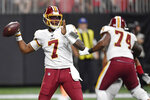 Washington Redskins quarterback Dwayne Haskins (7) works in the pocket against the Atlanta Falcons during the second half an NFL preseason football game, Thursday, Aug. 22, 2019, in Atlanta. (AP Photo/Mike Stewart)