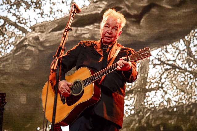 FILE - This June 15, 2019 file photo shows John Prine performing at the Bonnaroo Music and Arts Festival in Manchester, Tenn.  Prine died Tuesday, April 7, 2020, from complications of the coronavirus. He was 73.  (Photo by Amy Harris/Invision/AP, File)