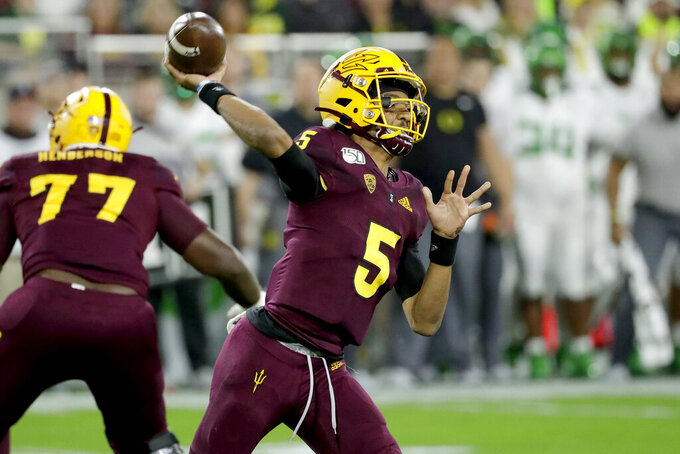 Arizona State quarterback Jayden Daniels (5) throws a pass against Oregon during the first half of an NCAA college football game Saturday, Nov. 23, 2019, in Tempe, Ariz. (AP Photo/Matt York)
