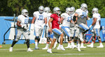 Detroit Lions quarterback Matthew Stafford goes through drills with the offense during NFL football training camp in Allen Park, Mich., Thursday, Aug. 27, 2020. (Kirthmon F. Dozier/Detroit Free Press via AP, Pool)
