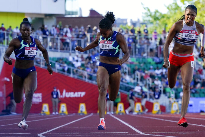 Javianne Oliver wins the second heat of the semi finals in women's 100-meter runat the U.S. Olympic Track and Field Trials Saturday, June 19, 2021, in Eugene, Ore. (AP Photo/Ashley Landis)