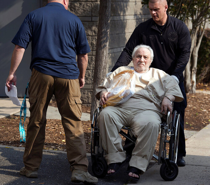 FILE - In this Sept. 5, 2017 file photo, Robert Gentile is wheeled into the federal courthouse in Hartford, Conn. Gentile, a mobster who for years denied suspicions from authorities that he knew anything about a trove of artwork valued in the millions that was stolen in a 1990 museum heist and remains missing, has died. He was 85. His attorney, Ryan McGuigan, said Gentile died Sept. 17, 2021, after a stroke.(Patrick Raycraft/Hartford Courant via AP, File)