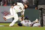 Milwaukee Brewers' Christian Yelich (22) is tagged out by San Francisco Giants shortstop Brandon Crawford on at attempted steal during the third inning of a baseball game in San Francisco, Wednesday, Sept. 1, 2021. (AP Photo/Jeff Chiu)