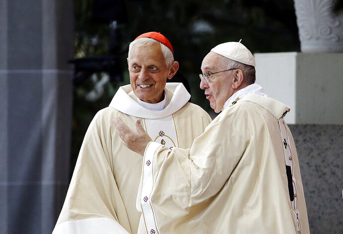 FILE - This Wednesday, Sept. 23, 2015 file photo shows Cardinal Donald Wuerl, archbishop of Washington, left, talking with Pope Francis after a Mass in the Basilica of the National Shrine of the Immaculate Conception  in Washington.  Pope Francis has accepted Friday Oct. 12, 2108 the resignation of Washington Cardinal Donald Wuerl after he became entangled in two major sexual abuse and cover-up scandals and lost the support of many in his flock. (AP Photo/David Goldman, File )