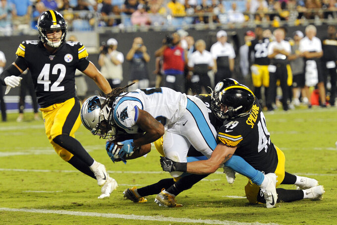 Carolina Panthers running back Jordan Scarlett (20) scores a touchdown while Pittsburgh Steelers linebacker Robert Spillane (49) and Pittsburgh Steelers linebacker Sutton Smith (42) look for the tackle during the second half of an NFL preseason football game in Charlotte, N.C., Thursday, Aug. 29, 2019. (AP Photo/Mike McCarn)