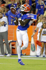 Florida wide receiver Tyrie Cleveland catches a pass for a 35-yard touchdown against UT Martin during the first half of an NCAA college football game Saturday, Sept. 7, 2019, in Gainesville, Fla. (AP Photo/John Raoux)