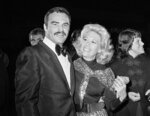 "FILE - In this Nov. 5, 1971 file photo, actress Dinah Shore and Burt Reynolds appear together in Los Angeles. Reynolds, who starred in films including ""Deliverance,"" ""Boogie Nights,"" and the ""Smokey and the Bandit"" films, died at age 82, according to his agent. (AP Photo/Harold Filan, File)"
