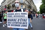 A young man arrives at the annual Gay Pride march in Paris, France, Saturday, July 4, 2020. The sign reads in French