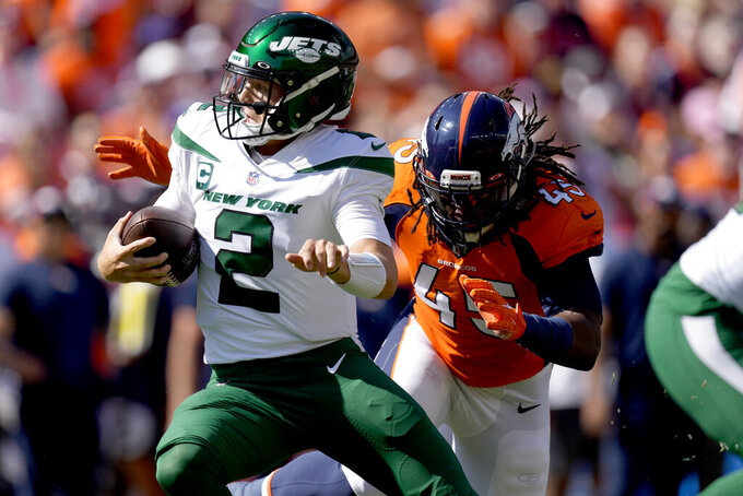 New York Jets quarterback Zach Wilson (2) is sacked by Denver Broncos linebacker A.J. Johnson (45) during the first half of an NFL football game, Sunday, Sept. 26, 2021, in Denver. (AP Photo/David Zalubowski)