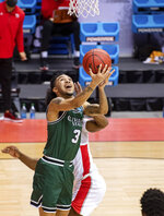Cleveland State guard Craig Beaudion (3) shoots a reverse layup to score during the first half of a first-round game against Houston in the NCAA men's college basketball tournament, Friday, March 19, 2021, at Assembly Hall in Bloomington, Ind. (AP Photo/Doug McSchooler)