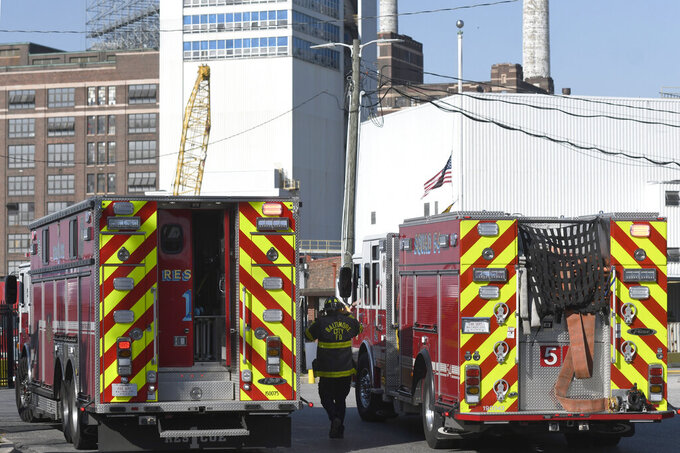 A firefighter responds to a fire at the Domino Sugar plant, Tuesday, April 20, 2021, in Baltimore. (AP Photo/Steve Ruark)