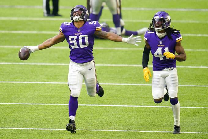 Minnesota Vikings linebacker Eric Wilson (50) celebrates with teammate Anthony Harris (41) after intercepting a pass during the second half of an NFL football game against the Detroit Lions, Sunday, Nov. 8, 2020, in Minneapolis. (AP Photo/Jim Mone)