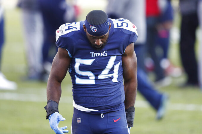 Tennessee Titans inside linebacker Rashaan Evans leaves the field after losing to the Baltimore Ravens in an NFL wild-card playoff football game Sunday, Jan. 10, 2021, in Nashville, Tenn. The Ravens won 20-13. (AP Photo/Wade Payne)