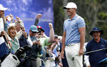 Brooks Koepka shares a laugh with the gallery after chipping onto the 18th green during the third round of The Players Championship golf tournament Saturday, March 16, 2019, in Ponte Vedra Beach, Fla. (AP Photo/Lynne Sladky)