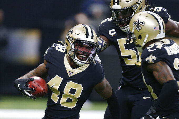 New Orleans Saints defensive back J.T. Gray (48) is congratulated by teammates after Gray recovered a fumble, during the first half at an NFL football game against the Carolina Panthers, Sunday, Nov. 24, 2019, in New Orleans. (AP Photo/Butch Dill)