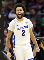 Buffalo's Jeremy Harris (2) celebrates after hitting a 3-point shot during the second half of the team's NCAA college basketball game against Bowling Green for the Mid-American Conference men's tournament title Saturday, March 16, 2019, in Cleveland. Buffalo won 87-73. (AP Photo/Tony Dejak)