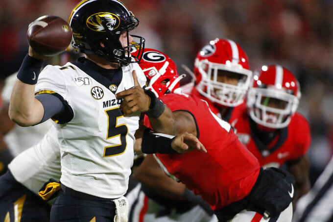 Missouri quarterback Taylor Powell (5) tries to get the ball away while being pressured by Georgia linebacker Nolan Smith (4) in the first half of a NCAA football game between Georgia and Missouri in Athens, Ga., on Saturday, Nov. 9, 2019. (Joshua L. Jones/Athens Banner-Herald via AP)