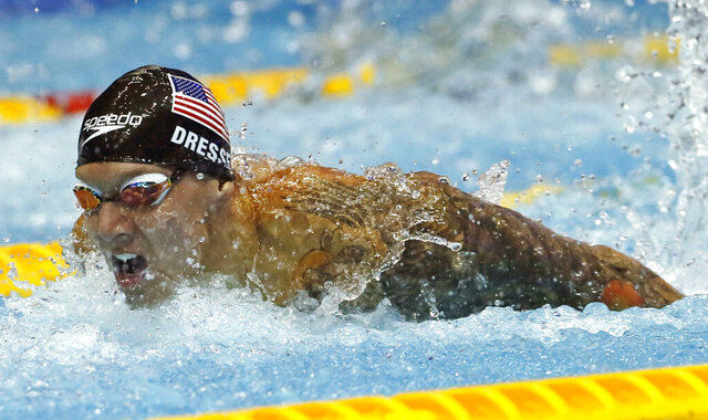 File-This Aug. 11, 2018, file photo shows U.S. swimmer Caeleb Dressel competing on his way to winning the men's 100m butterfly final during the Pan Pacific swimming championships in Tokyo.  In the post-Michael Phelps world, Dressel fits snugly into the successor's slot. Coming off two dynamic performances at the world swimming championships, Dressel figures to be one of the biggest stars at the 2020 Tokyo Games.  Yet he is reticent to step into the spotlight. (AP Photo/Koji Sasahara, File)