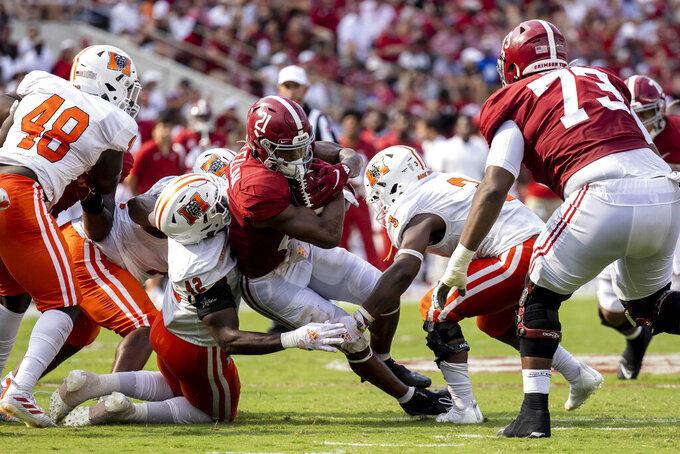 Alabama running back Jase McClellan (21) runs through Mercer linebacker Alvin Ward Jr. (42) during the first half of an NCAA college football game, Saturday, Sept. 11, 2021, in Tuscaloosa, Ala. (AP Photo/Vasha Hunt)