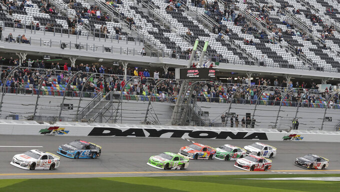 Pole sitter Christian Eckes (15) and Thad Moffitt (46) lead the field to start the ARCA series auto race at Daytona International Speedway, Saturday, Feb. 9, 2019, in Daytona Beach, Fla. (AP Photo/John Raoux)